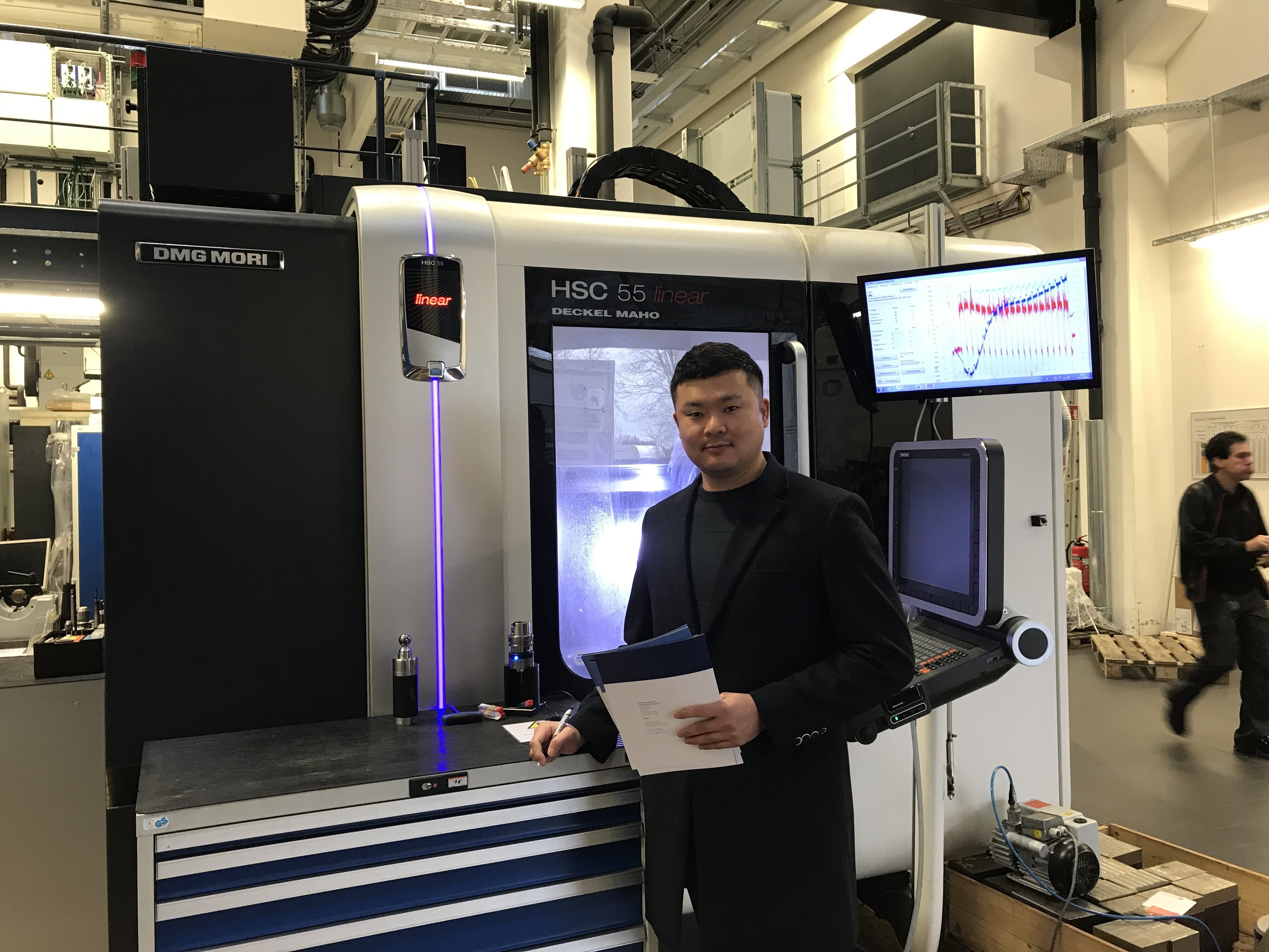 Researcher in front of machine tool